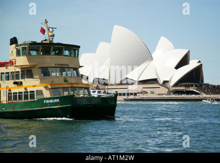 A Ferry crosses in front of the Opera House in Sydney Harbour - Stock Photo