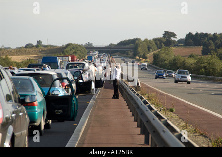 Stationary traffic delayed by an accident on the M40 motorway. - Stock Photo