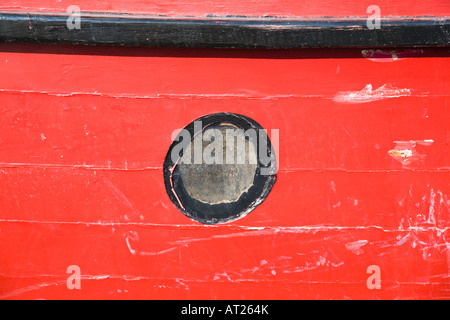 A porthole in an old wooden boat. UK. - Stock Photo