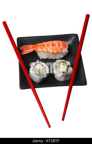 Maki and Nigiri Sushi on tray with Chopsticks - Stock Photo