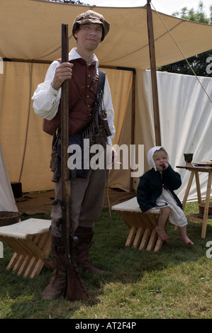 English civil war soldier and daughter in a field tent played during a sealed knot reenactment - Stock Photo