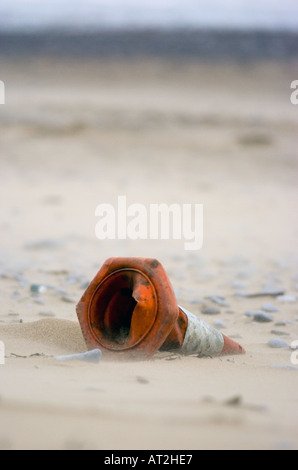 Abandoned traffic cone at Horton beach on the Gower Peninsular, UK. - Stock Photo