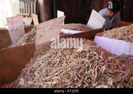 Dried fish on display for sale on a stall at the Sunday Market in Kuching, Sarawak, Borneo, Malaysia - Stock Photo