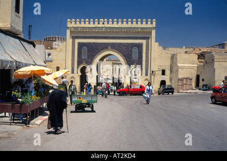 Bab bou Jeloud city gate to medina, pedestrians, blue tiled archway, crenellated top, Fes, Middle Atlas, Morocco, - Stock Photo