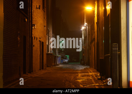 narrow deserted alleyway backstreet empty behind shops and bars in belfast city centre - Stock Photo