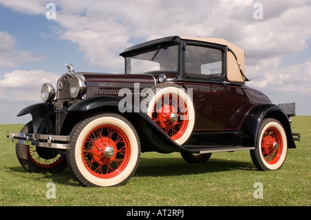 A classic American Model A Ford motor car on grass in the sunshine - Stock Photo