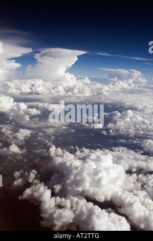 Picturesque aerial sea of high noon fluffy Clouds in a blue Sky with cool colors in a vertical technicolor view