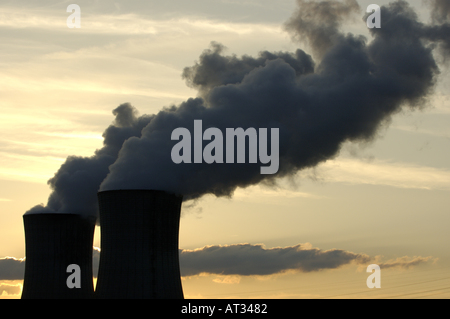 Smoke emitting from cooling towers at a nuclear power plant in the Rhone River Valley, Drome, France. - Stock Photo