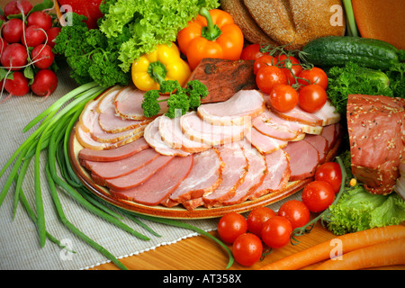 Ham cold meats platter with assorted vegetables - Stock Photo