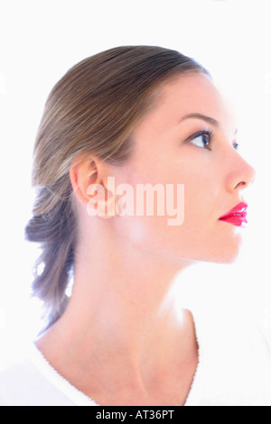 A portrait of young woman in her 20s, profile - Stock Photo