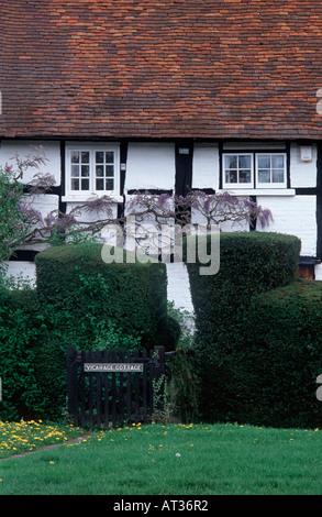 Timber framed Vicarage Cottage with flowering wisteria, Brockham Green, Brockham, Surrey, England - Stock Photo