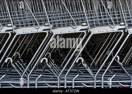A detailed view of shopping carts stacked in a row outside a supermarket - Stock Photo