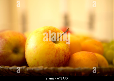 A basket of fruit on a table, close-up - Stock Photo