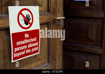 No unauthorised persons sign on an open door - Stock Photo