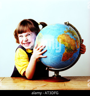 A small girl holding a globe - Stock Photo