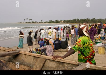 The Gambia Gunjur fishing villagers awaiting return of boats - Stock Photo