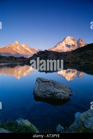 the Dru and Aiguille de Argentiere reflected in the Lac des Cheserys Massif du Mont Blanc nr Chamonix Savoie France - Stock Photo