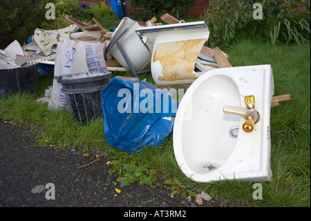 builders bathroom rubble including sink lying in a garden during home improvements - Stock Photo