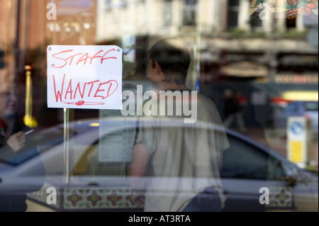 staff wanted hand written sign in restaurant window in Belfast city centre - Stock Photo