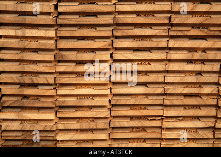 Four column stack of parquet size wooden flooring slabs end on - Stock Photo