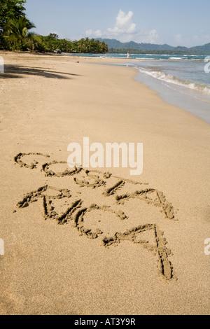 Costa Rica Caribbean Coast words Costa Rica written in sand on beach - Stock Photo