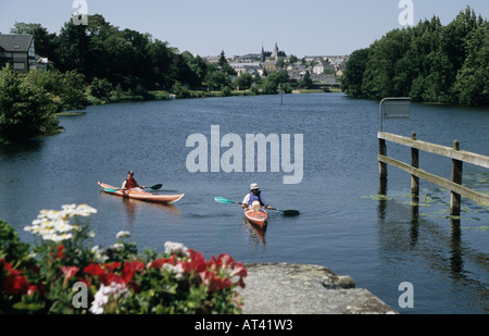 Nick Haslam and Jerome Gopier entering a lock on the Mayenne river close to Chateau Gontier France - Stock Photo