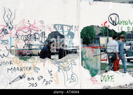 The Fall of the Berlin wall, 1989. A view to the east through a hole in the Berlin Wall - Stock Photo