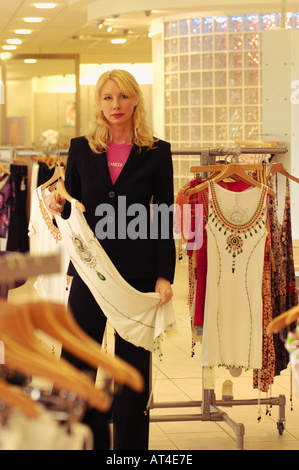 woman standing in a clothes store - Stock Photo