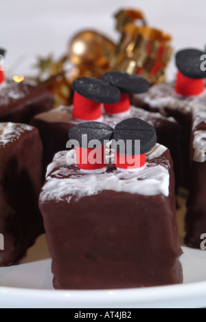 A Selection of Fancy Cakes Designed for the Christmas Market - Stock Photo