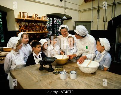 UK Cheshire Education Dunham Massey Hall school children in the Victorian Kitchen - Stock Photo