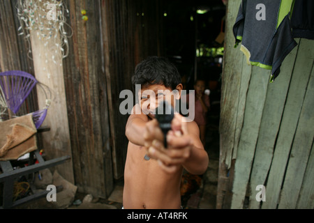 Children joining local gangs who become extremely violent - Stock Photo