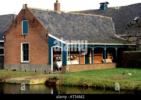 Koudekerk South Holland milk churn can churns cans dairy farm - Stock Photo