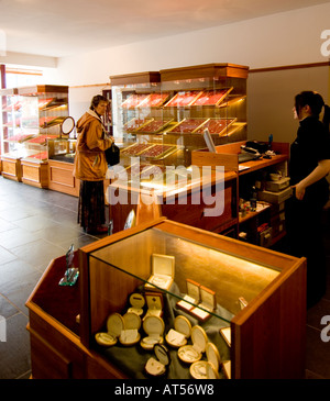 person shopping for gifts at rhiannon gold centre and craft shop interior tregaron ceredigion mid wales april 2006 - Stock Photo