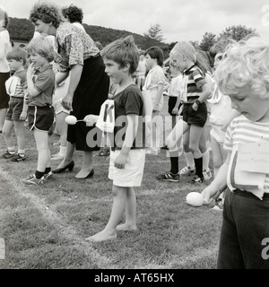 Young primary school children getting ready for the egg and spoon race on school sports day Llanwrda Wales UK  KATHY - Stock Photo