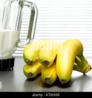 Bananas in front of mixer, close-up - Stock Photo
