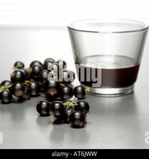 A glass of blackcurrant juice close-up - Stock Photo