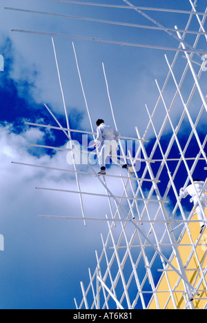 Chinese Construction Workers erecting Bamboo Culm Scaffolding - Stock Photo