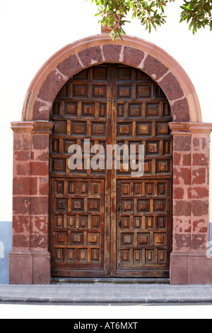 old traditonal heavy wooden double door strengthened doorway in La Laguna tenerife canary islands spain - Stock Photo