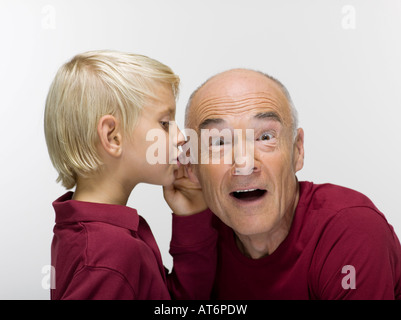 Grandson (8-9) and grandfahter, portrait - Stock Photo