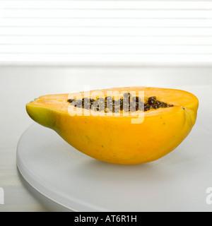 Sliced papaya on plate, close-up - Stock Photo