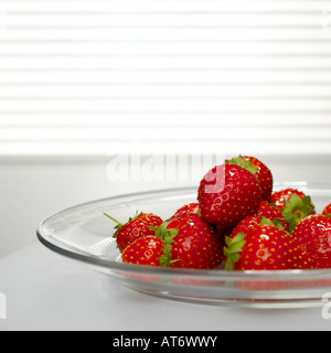 Strawberries on plate, close-up - Stock Photo