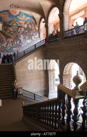 Palacio Nacional (National Palace) Central Arch stairs with Diego Rivera murals in Mexico City, DF, Mexico. - Stock Photo
