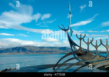 Metal sculpture of sunship Solfar by Jon Gunnar Arnason in Reykjavik city Iceland - Stock Photo