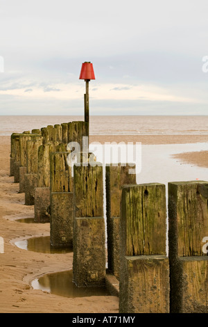 Breakwater and Groynes on Cleethorpes Beach North East Lincolnshire - Stock Photo