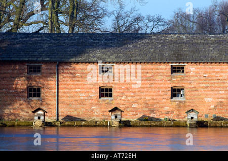 Ducks wooden  nesting boxes at Shugborough Mill pond in Staffordshire 'Great Britain' - Stock Photo