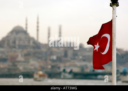 The Turkish flag seen against part of the Istanbul skyline. - Stock Photo