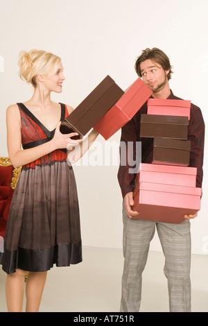 Man carrying shoeboxes, portrait - Stock Photo