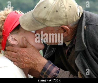 Man on Donkey kissing my wife along country road on the island of Crete Greece - Stock Photo