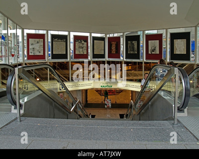 escalators at Willy Brandt Platz in Essen with art gallery - Stock Photo