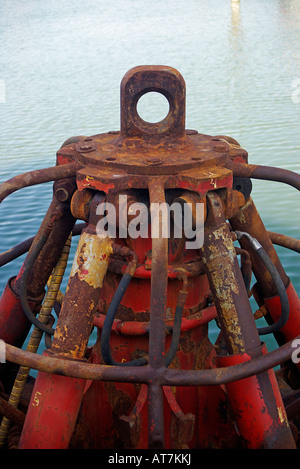 Machine that is used to deepen and to clean the ports, rivers, channels, extracting of them mire, stones, sand - Stock Photo